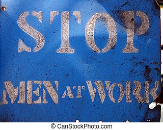 Stop - Men at Work - Dirty sign in a train yard from older...