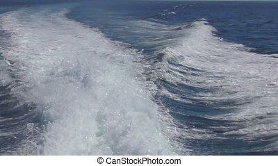 View from the rear of moving speedboat