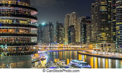 View of Dubai Marina Towers and canal in Dubai night timelapse