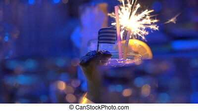 Bar cocktails with sparkler and Greek flag - Close-up shot...