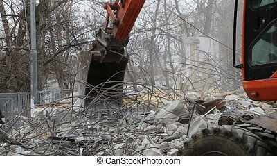 Excavator demolition old house - Excavator machinery working...