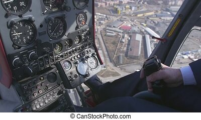 View at control system, pilot hold lever of helicopter...