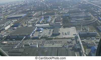 Aerial view from helicopter fly above industrial premises in...