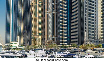 Close up View of Dubai Marina tallest Towers in Dubai at day timelapse