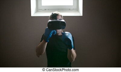 Man boxing in VR glasses - Steadycam shot of a man boxing...