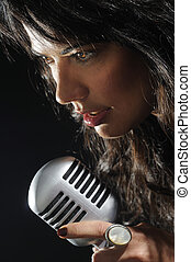 Beautiful female singer - Close up portrait of young...
