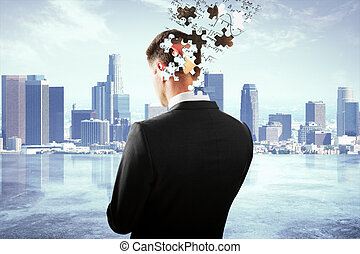 Head breaking into puzzle pieces