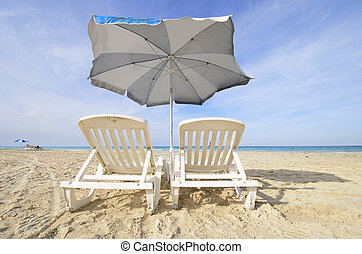 Chairs and umbrella on tropical cuban beach - Two chairs...