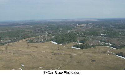 Aerial view from helicopter fly above green forest, field...