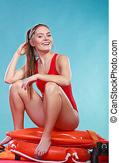 Happy lifeguard woman sitting on rescue ring buoy - Happy...