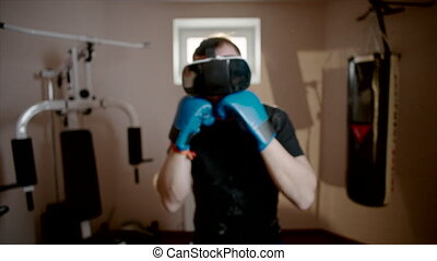 Man boxing the gym using VR glasses - Out-of-focus steadycam...
