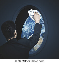Man wiping spaceship window - Businessman wiping dark...