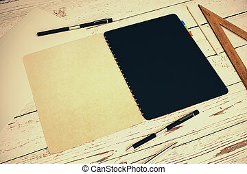 Notepad on light wooden table