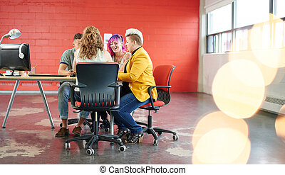 Unposed group of creative business people in an open concept...