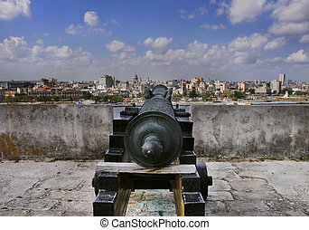 Havana skyline and cannon - A view of havana skyline and old...