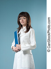 Healthcare collection - Pretty brunette doctor with blue folder