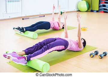 Fit women doing workout, yoga pilates back bend exercise at...