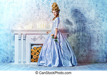 romantic age - Elegant young woman in a lush white medieval...