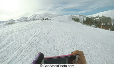 Shooting on smartphone ski slopes - Girl takes on your...