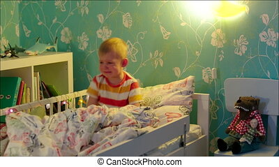 Little boy sitting and crying in his bed - Fast rewind shot...