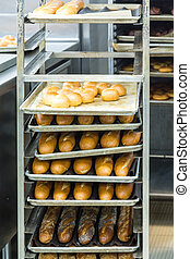 Loaves of Bread in Commercial Kitchen - Fresh baked bread on...