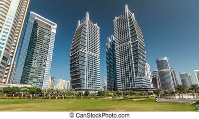 Residential buildings in Jumeirah Lake Towers timelapse hyperlapse in Dubai, UAE.