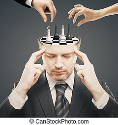 Chess tournament - Thoughtful businessman with chess board...