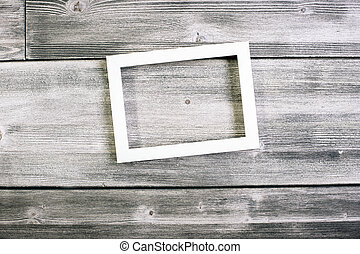 See through frame - See-through frame hanging on wooden...