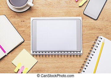 Tablet on spiral copybook - Wooden desktop with blank tablet...