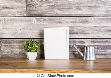 Blank frame and watering-pot - Blank frame, plant and...
