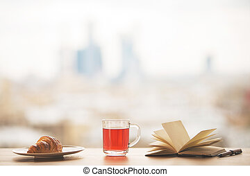 Desktop with tea and book - Desktop with cup of tea,...