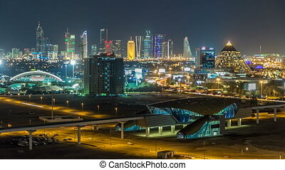 Scenic Dubai downtown skyline timelapse at night. Rooftop...