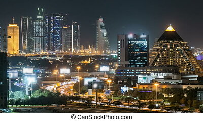 Scenic Dubai downtown skyline timelapse at night Rooftop...