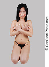 Nude Asian girl kneeling. - A pretty, naked Chinese woman...