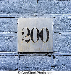 Number 200 - House number two hundred on a aluminum plate.