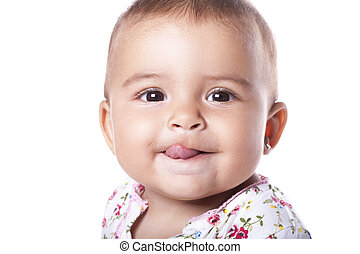 Portrait of lovely baby girl sticking tongue out - Cute baby...