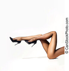 Sexy legs of a young woman in stockings - Beautiful legs in...
