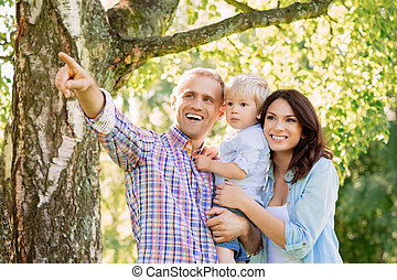 Happy smiling family spending time together with a tree on...
