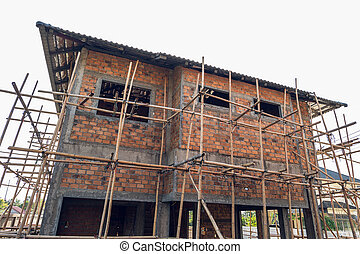 building residential construction house with scaffold for...