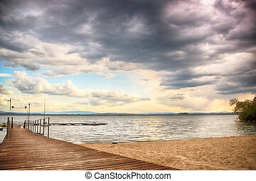 Beautiful summer landscape with cloudy sky and natural lake...