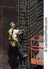 Vertical - Worker placing rebar