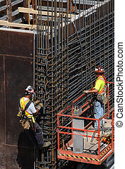 Upright rebar - Men placing rebar
