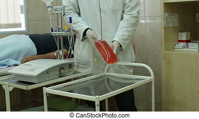Apparatus for plasmapheresis - Hands of doctor in gloves...