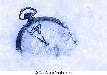 Pocket watch in snow, New Year 2017 greeting card
