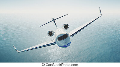 Image of white luxury generic design private jet flying over...