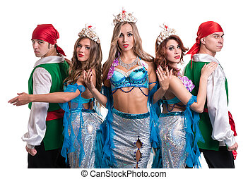 Carnival dancer team dressed as mermaids and pirates.  Isolated on white