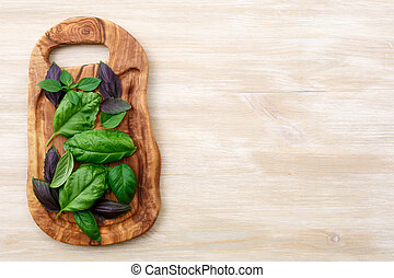 Heirloom basil on wooden table - Heirloom basil on olive...