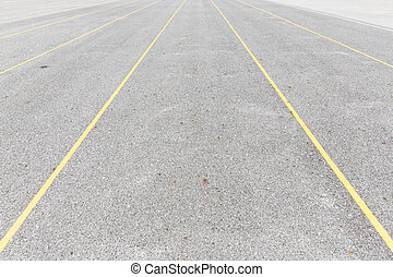 Concrete road texture with yellow color lines, outdoor...