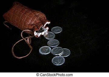 Grunge pouch with silver coins on dark background - Still...