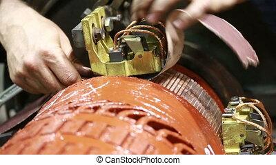 Mechanic repairing electric generator, repair of starter....
